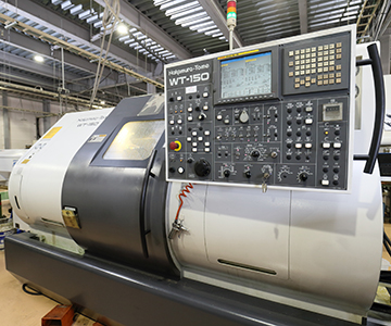 進興金属工業株式会社 バーフィーダー付きCNC旋盤機